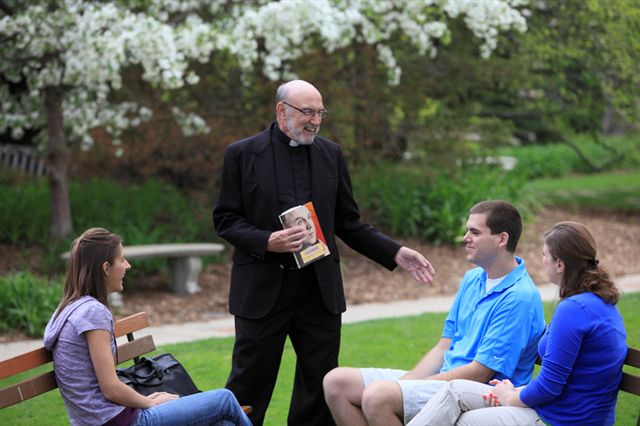 Fr_Hauser_and_students